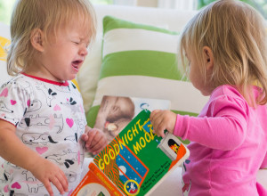 toddlers fighting over books